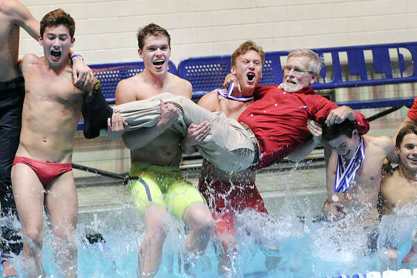 Greenwich swimmer Conrad Moss, center, screams as he and his teammates including Aedan Lewis, second from left, jump into the pool holding their coach, Terry Lowe, as they celebrated their victory in State Open Boys High School Championship Swim Meet at the Yale University Pool in New Haven, Conn., Saturday, March 18, 2017. Greenwich won its fifth straight State Open title by six points in a closely contested meet that came down to final event.