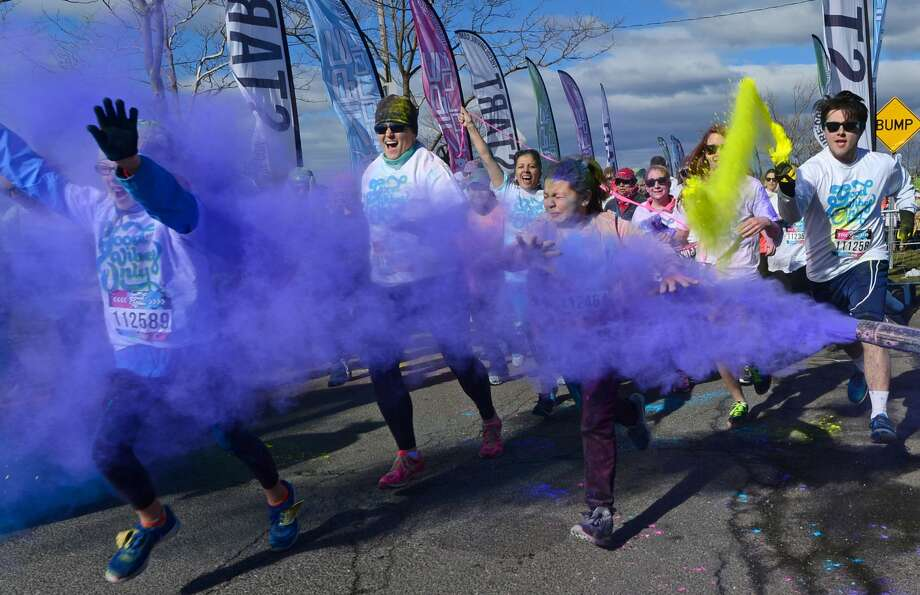 Runners set off for the Color Vibe 5k road race as part of the Good Vibes 2017 tour Saturday, April 8, 2017, at Veterans Memorial Park in Norwalk, Conn. A portion of the proceeds from the run will benefit the National Alliance of Mental Illness of Southwestern Connecticut. Photo: Erik Trautmann/Hearst Connecticut Media