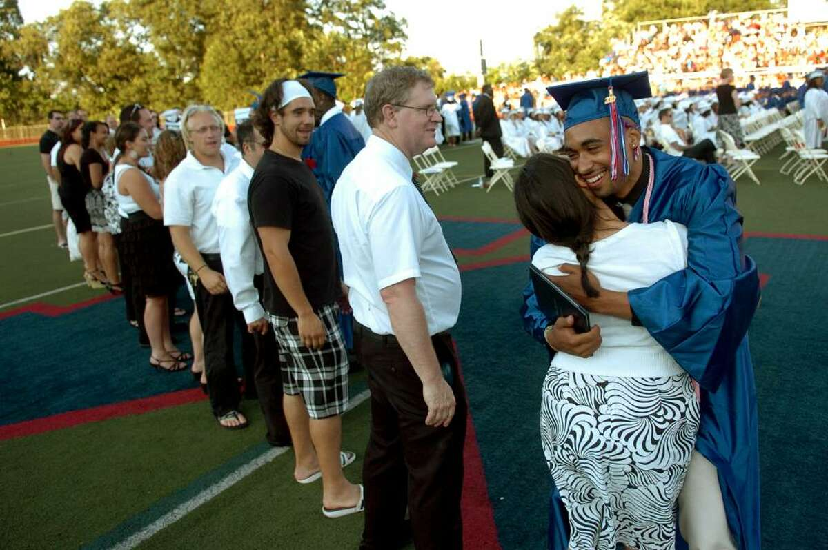 Graduate Deandre Horton-Williams hugs teacher Rebecca Dombrowski, during Brien McMahon's 49th Commencement Exercises in Norwalk, Conn. on Tuesday June 29, 2010.