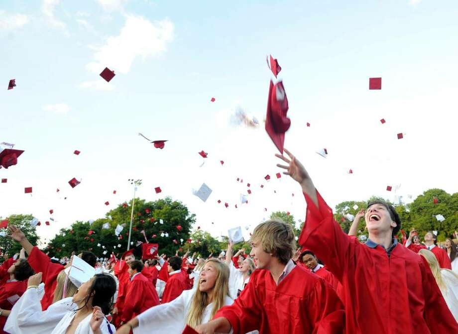 T.J. Franco, right, and classmates throw their graduation caps into the air at the end of the Greenwich High School 2010 graduation ceremony, Tuesday evening, June 29, 2010. Photo: Bob Luckey / Greenwich Time
