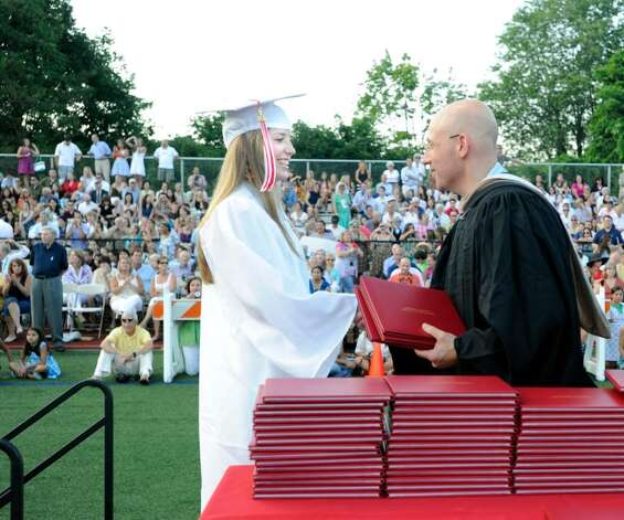 Greenwich High School graduating senior Heather Fox, 17, left, receives her diploma from Jonathan Cohen  of the Greenwich Board of Education during the Greenwich High School 2010 Graduation ceremony,  Tuesday evening, June 29, 2010. Photo: Bob Luckey / Greenwich Time