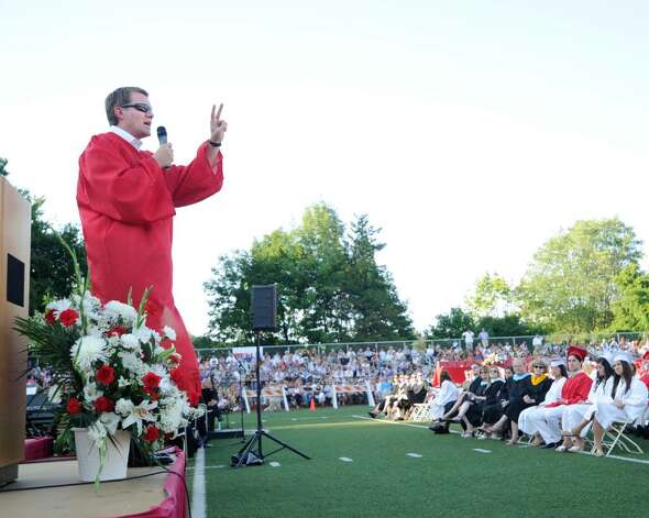 Greenwich High School commencement speaker Scott Case, GHS class of 1988, speaks during the Greenwich High School 2010 graduation ceremony, Tuesday evening, June 29, 2010.  Case co-founded Priceline.com. Photo: Bob Luckey / Greenwich Time