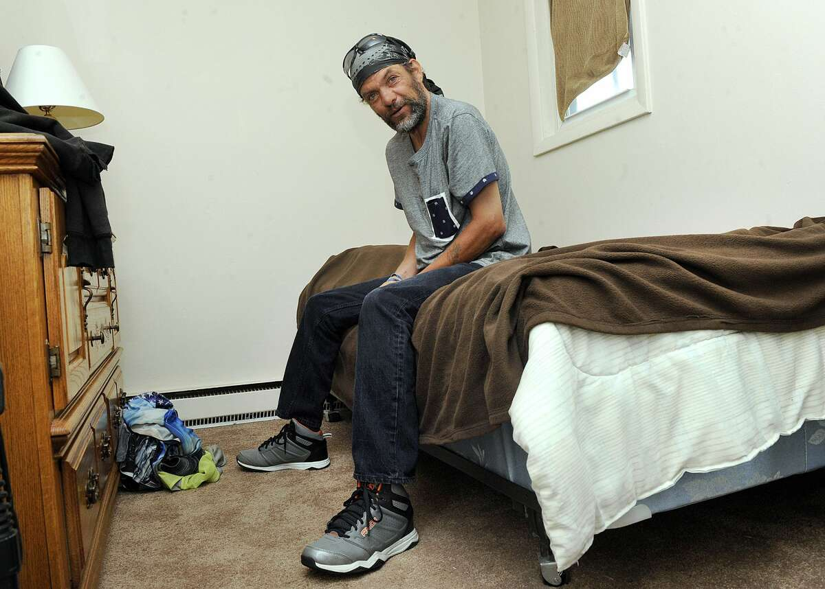 John Martin is photographed in the bedroom of his Danbury apartment Wednesday, June 21, 2017. Martin, 47, was homeless for decades. Recently, through the efforts of Catholic Charities, he received housing in Danbury.