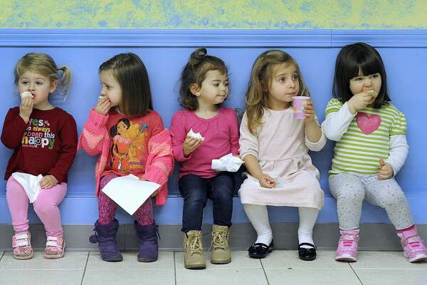 After a morning of story time and music, it's snack time for kids enjoying the Fun and Friends weekly program for pre-schoolers at the Brookfield Library led by Mary Proudfoot, the children's librarian, Wednesday, March 1, 2017. They are from left, Kennerly Doenges, Zoe Silver, Kelsey Doorly, Gabriella Caputo and Stella Peters, all age 3.