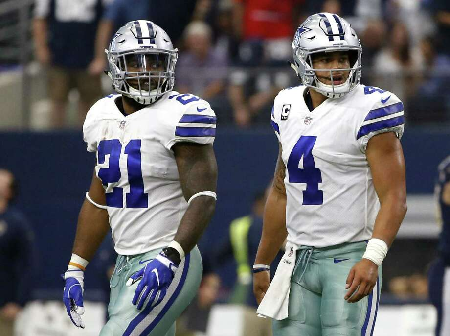 Dallas Cowboys running back Ezekiel Elliott (21) and quarterback Dak Prescott (4) walk off the field Elliott has one game remaining in his six-game suspension, when Dallas travels to Oakland on Sunday night and will be allowed back in the team facility on Monday. Photo: Ron Jenkins /AP / FR171331 AP