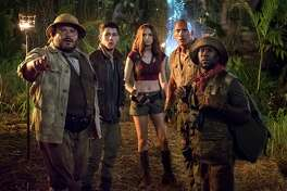"Jack Black, Nick Jonas, Karen Gillan, Dwayne Johnson and Kevin Hart star in the film, ""Jumanji: Welcome to the Jungle."" (Frank Masi/Sony Pictures)"