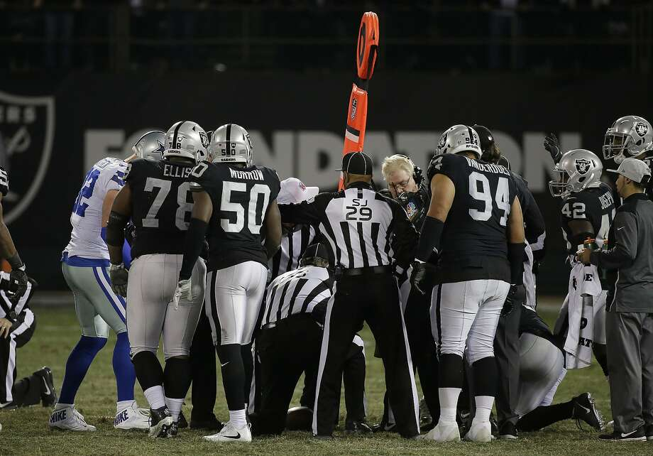 Dallas Cowboys and Oakland Raiders players await the ruling of a measurement during the second half of an NFL football game in Oakland on Dec. 17, 2017 Photo: Eric Risberg, Associated Press