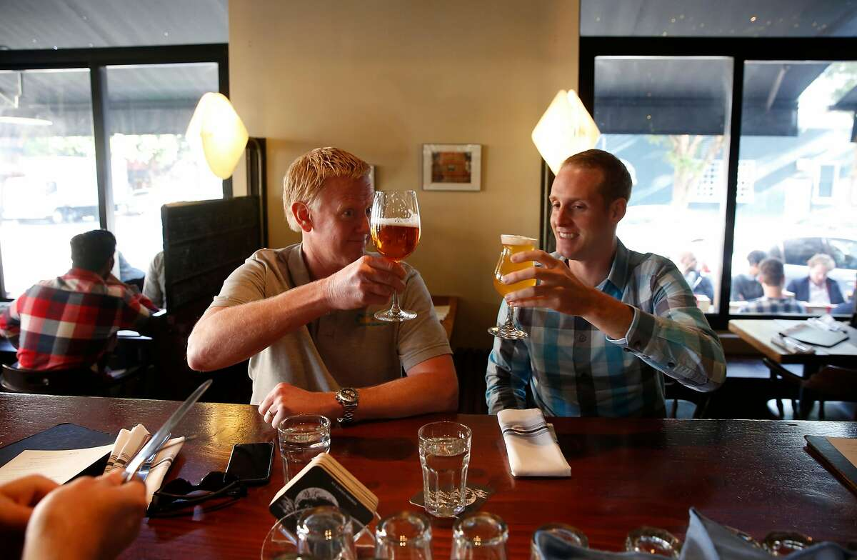 David Yates, (left) and Matt Justus during lunch at Monk's Kettle restaurant and bar in the Mission neighborhood on Monday December 18, 2017, in San Francisco, Ca.