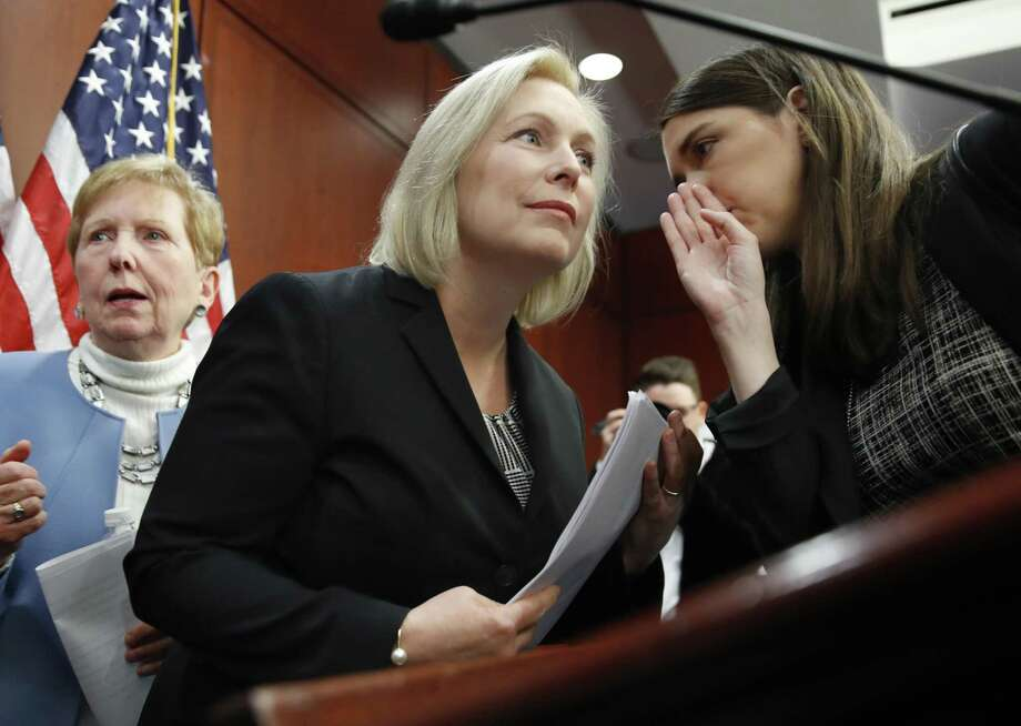 """Sen. Kirsten Gillibrand, center, listens to a staffer before answering questions at a news conference, where she discussed what she termed a """"sexist smear"""" in a tweet from President Trump. A reader says an E-N article on the controversy was incomplete. Photo: Jacquelyn Martin /Associated Press / Copyright 2017 The Associated Press. All rights reserved."""