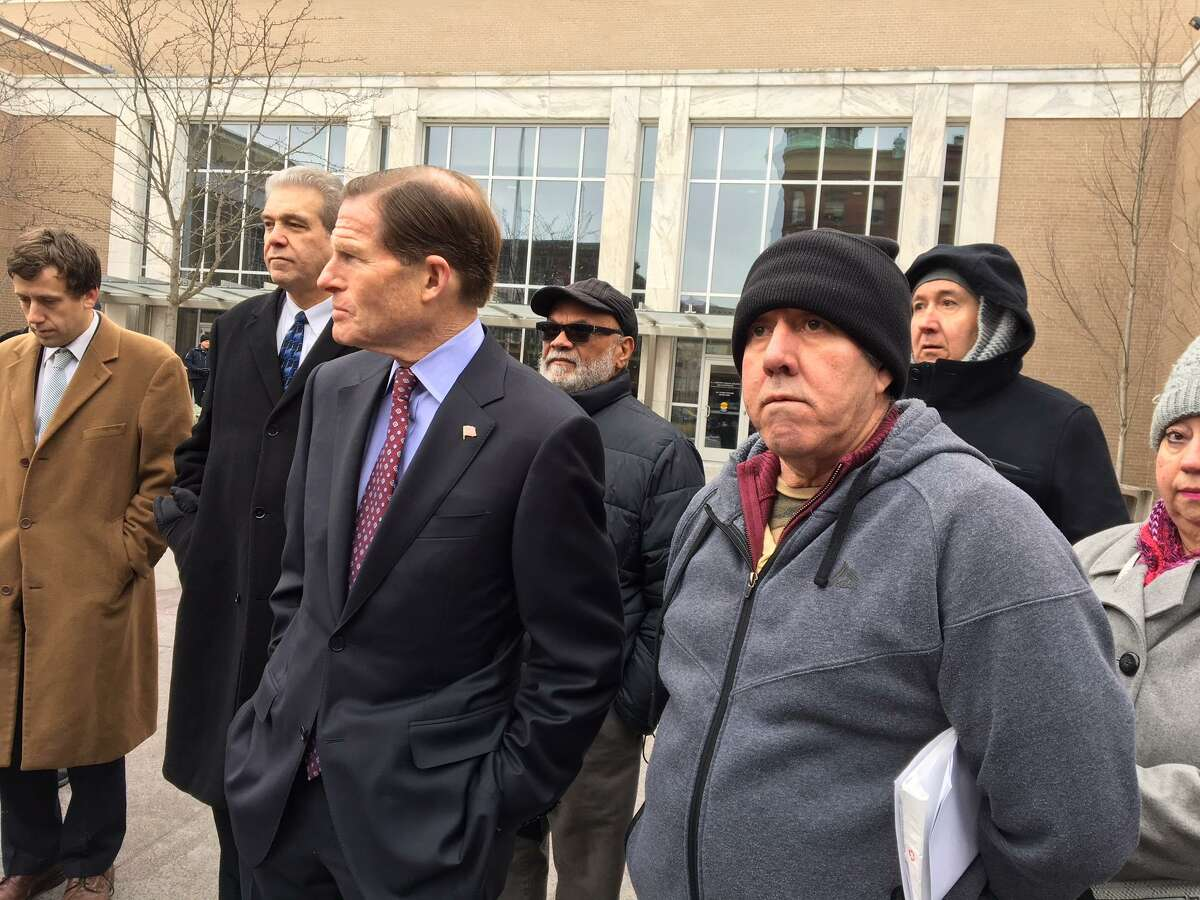 U.S. Sen. Richard Blumenthal, D-Conn., left, with Francisco Acosta at a rally for the Colombian native who ICE has ordered deported