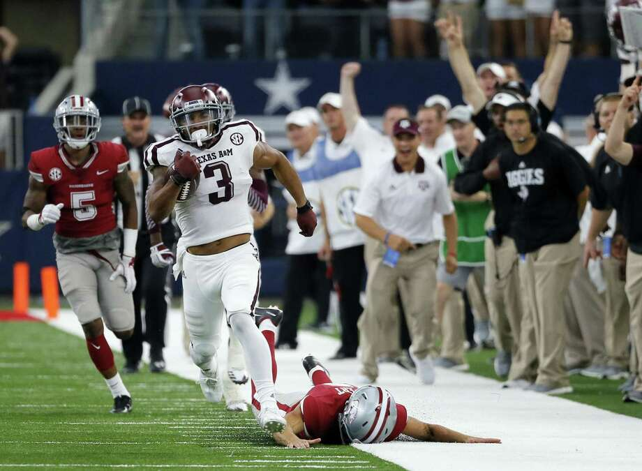 Texas A&M wide receiver Christian Kirk (3) evades Arkansas tackles on a 100-yard kick-off return for a touchdown against Arkansas in Arlington. Kirk was selected to the AP All-Conference SEC team announced Monday, Dec. 4, 2017. Photo: Tony Gutierrez /Associated Press / Copyright 2017 The Associated Press. All rights reserved.