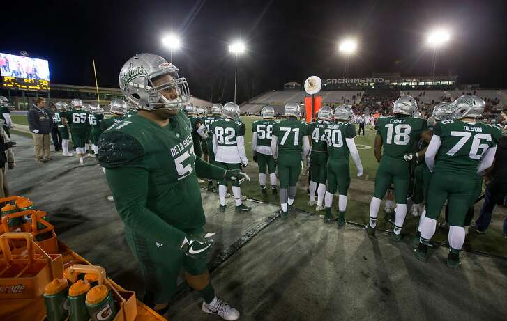 De La Salle�s Tuli Letuligasenoa (51) stands at the back of the bench as his team goes down to Mater Dei, during the fourth quarter of the Open Division 2017 CIF State Football Championship Bowl Game, on Saturday, Dec. 16, 2017 in Sacramento, Calif. Mater Dei won 52-21.