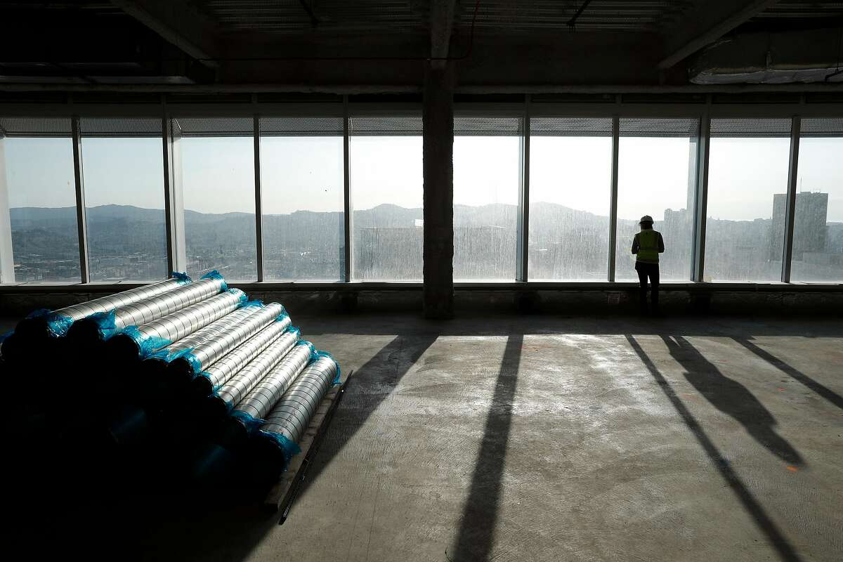 Laura Kerl with Boston Properties, looks out a window in an unfinished office space at the Salesforce Tower in San Francisco, Calif., Thursday, November 2, 2017.