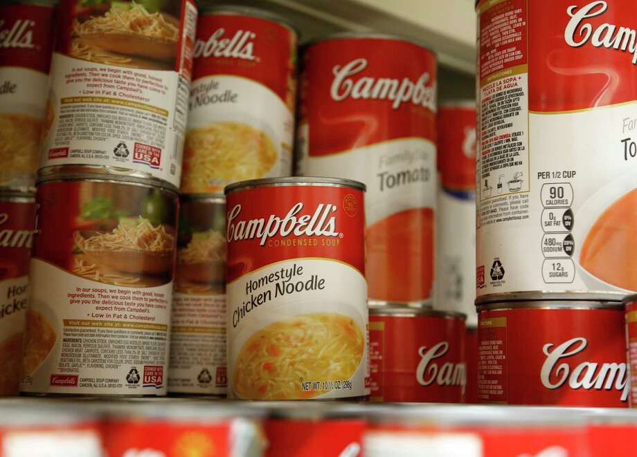 In this Monday, May 22, 2017, photo, cans of Campbell's soup are displayed at a supermarket in Englewood, N.J. Campbell Soup announced Monday, Dec. 18, 2017, that it will spend $4.87 billion in cash for Snyder's-Lance, gorging on a snack market that has grown increasingly competitive. (AP Photo/Seth Wenig) ORG XMIT: NYBZ143 Photo: Seth Wenig / Copyright 2017 The Associated Press. All rights reserved.