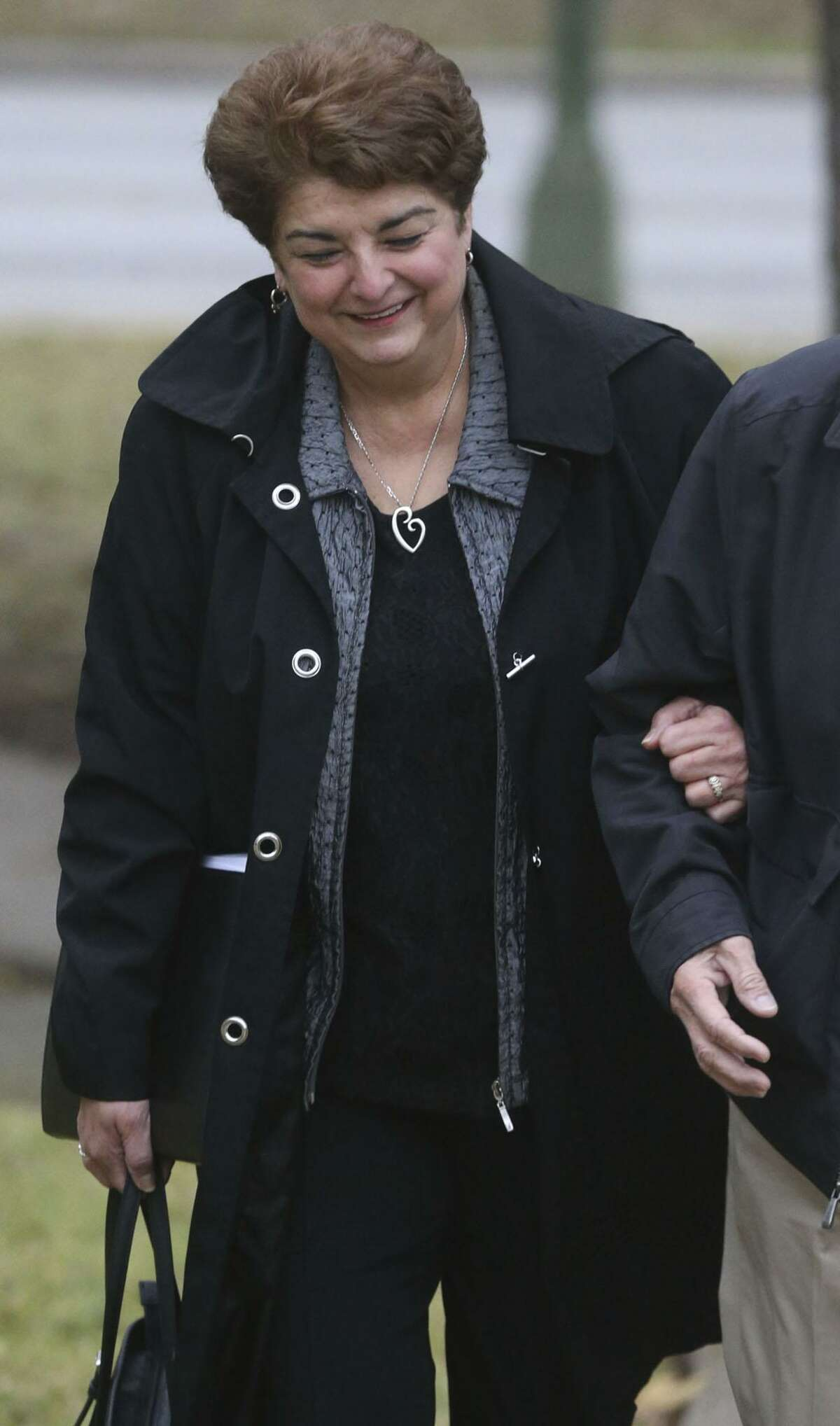 Olga Hernandez approaches the John H. Wood, Jr. Federal Courthouse Monday December 18, 2017. Hernandez is a former San Antonio Independent School District trustee and is on trial for bribery and is expected to testify in her own defense.