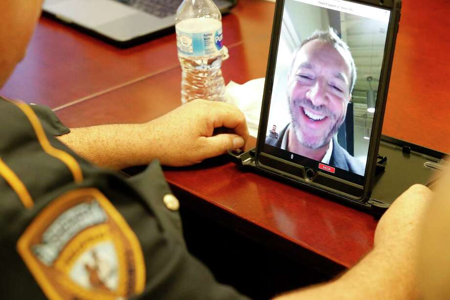 Cloud 9 CEO J.C. Adams calls aids Harris County Sheriff Deputy Fred Lerma during a training session of a telepsych program Tuesday, Dec. 12, 2017, in Houston. Photo: Steve Gonzales, Houston Chronicle / © 2017 Houston Chronicle