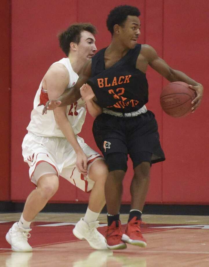 Greenwich's Billy Nail, left, and Stamford's Jaden Bell battle in the high school boys basketball game at Greenwich High School in Greenwich on Monday. Stamford won 58-46. Photo: Tyler Sizemore / Hearst Connecticut Media / Greenwich Time