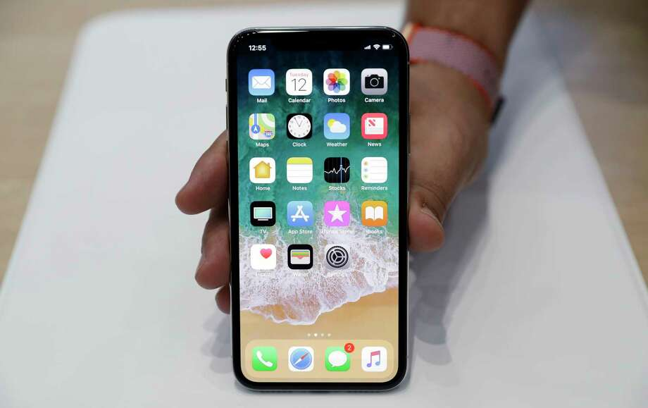 FILE - In this Tuesday, Sept. 12, 2017, file photo, the new iPhone X is displayed in the showroom after the new product announcement at the Steve Jobs Theater on the new Apple campus in Cupertino, Calif. Apple is offering a nifty way to unlock its new iPhone X...just stare at it. Face ID, Apple's name for its facial-recognition technology, replaces the fingerprint sensor found on other models. (AP Photo/Marcio Jose Sanchez, File) Photo: Marcio Jose Sanchez, STF / Copyright 2017 The Associated Press. All rights reserved.