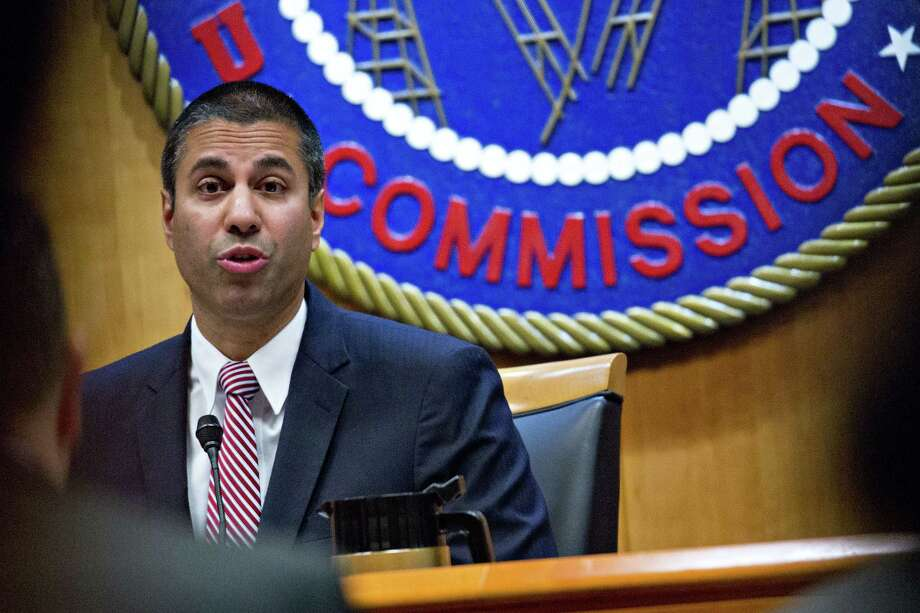 Ajit Pai, chairman of the Federal Communications Commission (FCC), speaks during an open commission meeting in Washington, D.C., U.S., on Thursday, Dec. 14, 2017. The FCC is slated to vote to roll back a 2015 utility-style classification of broadband and a raft of related net neutrality rules, including bans on broadband providers blocking and slowing lawful internet traffic on its way to consumers. Photographer: Andrew Harrer/Bloomberg ORG XMIT: 775091646 Photo: Andrew Harrer / © 2017 Bloomberg Finance LP