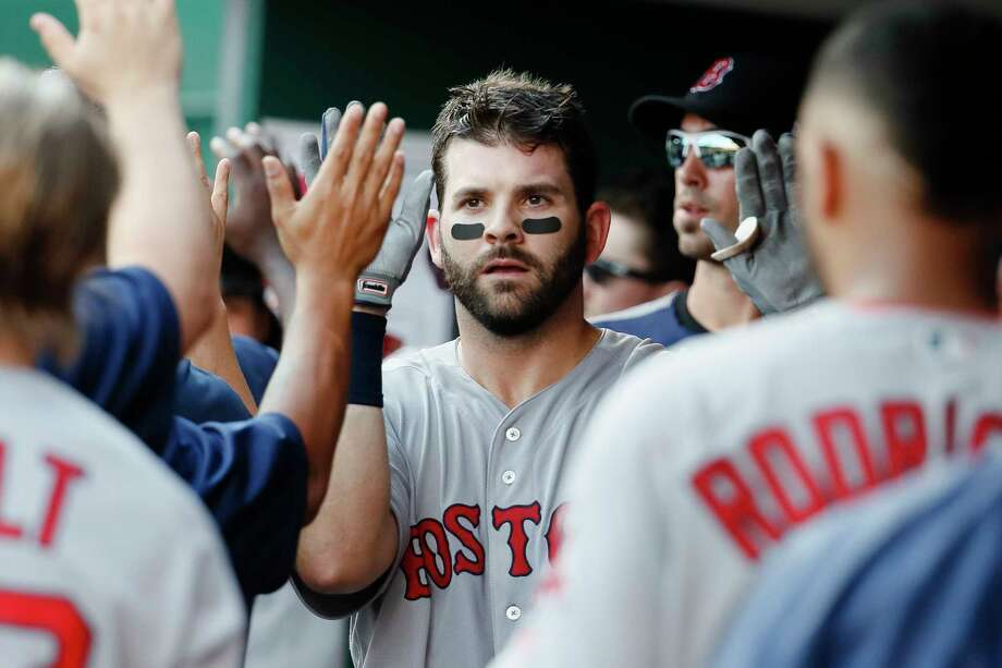 FILE - This Sept. 23, 2017 file photo shows Boston Red Sox's Mitch Moreland celebrating in the dugout after hitting a three-run home run off Cincinnati Reds starting pitcher Robert Stephenson in the sixth inning of a baseball game in Cincinnati. Moreland is remaining with the Red Sox, agreeing to a $13 million, two-year contract, Monday, Dec. 18, 2017. (AP Photo/John Minchillo, file) ORG XMIT: NYPS202 Photo: John Minchillo / AP