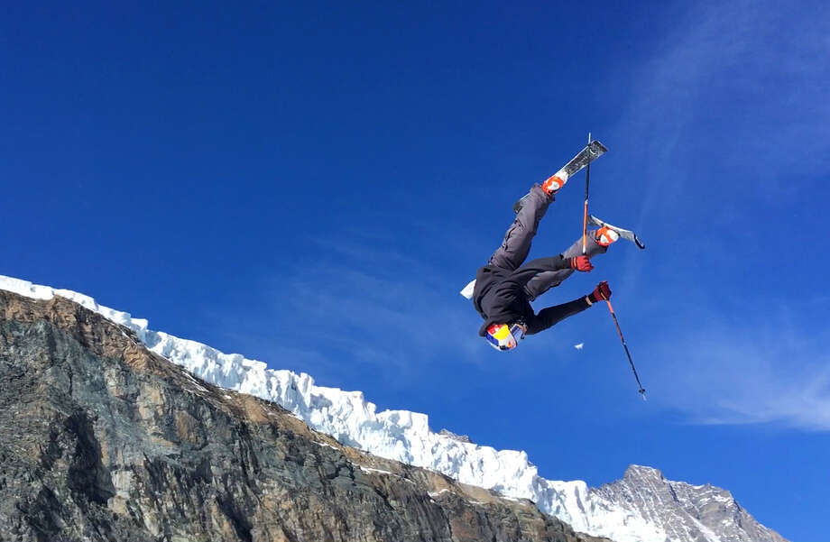 This photo taken from a 4K video and dated Wednesday, Oct. 18, 2017 shows a skier performing a jump during training on the glacier above Saas-Fee, Switzerland. The glacier attracted skiers and snowboard athletes from an array of nations, who came hunting for snow on which to train early in the season ahead of the 2018 Pyeongchang Olympics. (AP Photo/John Leicester) ORG XMIT: PAR511 Photo: John Leicester / Copyright 2017 The Associated Press. All rights reserved.
