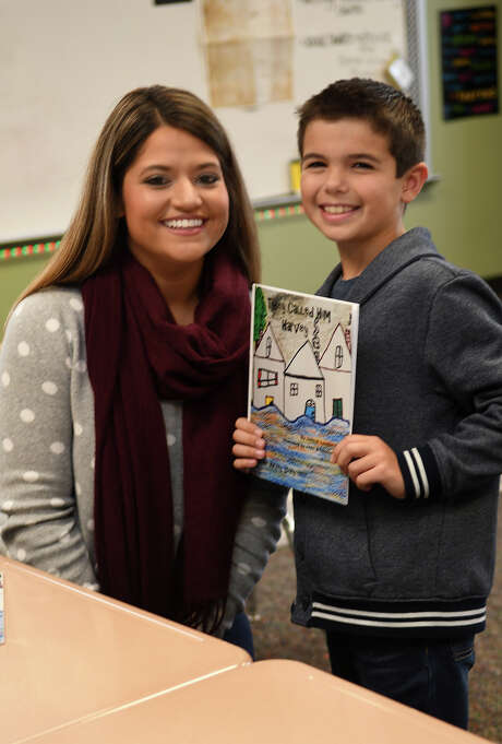 "Landon Hayek, 9, with Creekview Elementary School teacher Kristin Khoobiar, displays his book, ""They Called Him Harvey."" Photo: Jerry Baker, Freelance / Freelance"