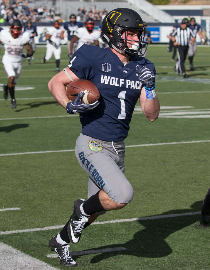 Nevada wide receiver McLane Mannix runs down the sideline against UNLV in the first half of an NCAA college football game in Reno, Nev. Saturday, Nov. 25, 2017. (AP Photo/Tom R. Smedes)