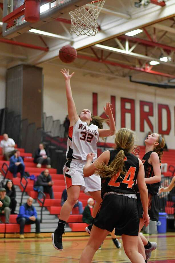 Olivia Parisi (32) of the Fairfield Warde Mustangs drives to the basket for a lay up during a game against the Ridgefield Tigers at Fairfield Warde High School on Monday December 18, 2017 in Fairfield, Connecticut. Photo: Gregory Vasil / For Hearst Connecticut Media / Connecticut Post Freelance