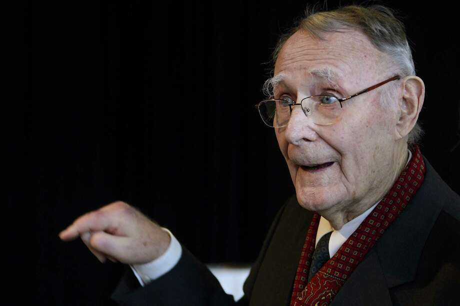(FILES) - Picture taken on December 3, 2012 shows Ikea founder Ingvar Kamprad gesturing prior the inauguration of the Margaretha Kamprad Chair of Environmental Science and Limnology at the Swiss Federal Institutes of Technology of Lausanne (EPFL) in Lausanne.  Kamprad is stepping down from the board of Inter Ikea, owner of the furniture giant's concept and brand, as his youngest son becomes chairman, the company said on June 5, 2103.  AFP PHOTO / FABRICE COFFRINIFABRICE COFFRINI/AFP/Getty Images Photo: FABRICE COFFRINI, Staff / AFP