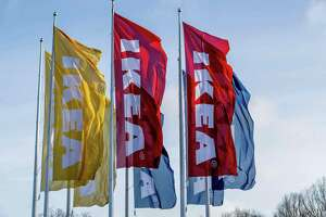Flags fly outside a store of Swedish furniture giant Ikea in the Dutch city of Delft. The EU is looking at Ikea's tax policies.
