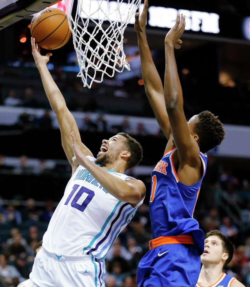Hornets guard Michael Carter-Williams goes up for two points while facing the Knicks during the first half of an NBA basketball game, Monday, Dec. 18, 2017, in Charlotte, N.C. (AP Photo/Jason E. Miczek) ORG XMIT: NCJM108 Photo: Jason E. Miczek / FR103426 AP