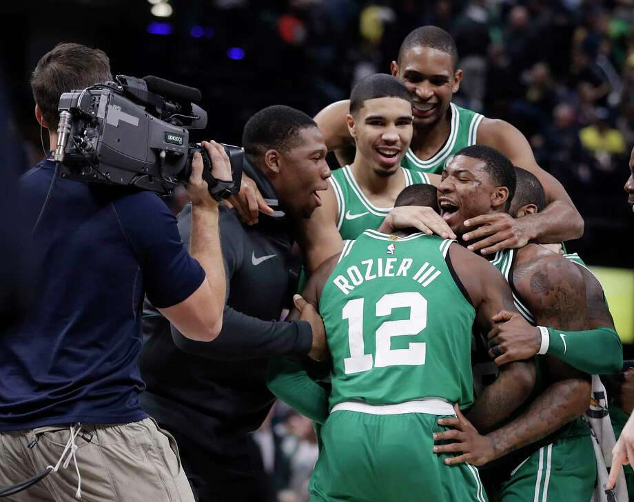 Boston Celtics' Terry Rozier (12) celebrates with teammates after they defeated the Indiana Pacers in an NBA basketball game, Monday, Dec. 18, 2017, in Indianapolis. (AP Photo/Darron Cummings) ORG XMIT: INDC112 Photo: Darron Cummings / Copyright 2017 The Associated Press. All rights reserved.