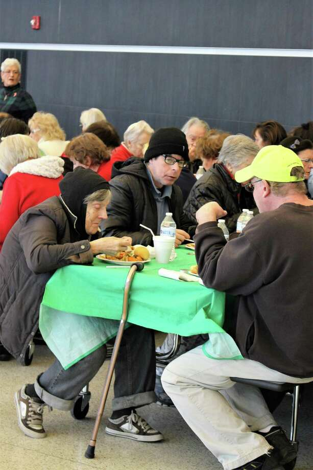 Students and staff at Emmett O'Brien Technical High School on Monday made the holidays more merry for area senior citizens and Valley folks in need, with the school's annual, free holiday dinner. Photo: Jean Falbo-Sosnovich / Hearst Connecticut Media