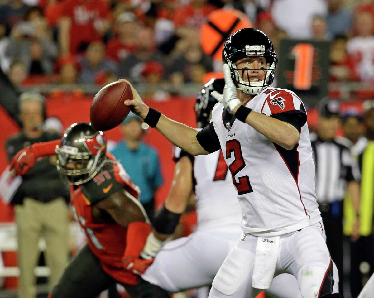 Atlanta Falcons quarterback Matt Ryan (2) looks for a receiver as his is rushed by Tampa Bay Buccaneers middle linebacker Kendell Beckwith, left, during the first half of an NFL football game, Monday, Dec. 18, 2017, in Tampa, Fla. (AP Photo/John Raoux) ORG XMIT: TPS201