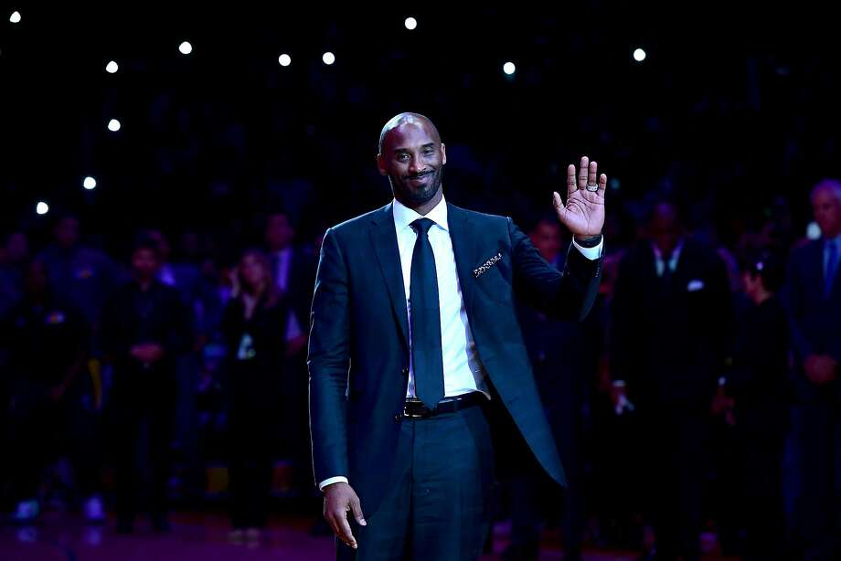 """FILE-- Kobe Bryant smiles at halftime as both his #8 and #24 Los Angeles Lakers jerseys are retired at Staples Center on Dec. 18, 2017 in Los Angeles.Bryant is nominated for an Oscar in the animated short category for """"Dear Basketball,"""" based on a poem he wrote in 2015 announcing his impending retirement from basketball. His nomination has led some to criticize the Academy for recognizing the former NBA star in the #MeToo era — in light of his 2003 sexual assault arrest. Photo: Harry How, Getty Images"""