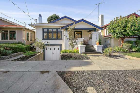 The Alameda home includes a partial basement and a workshop in the garage.