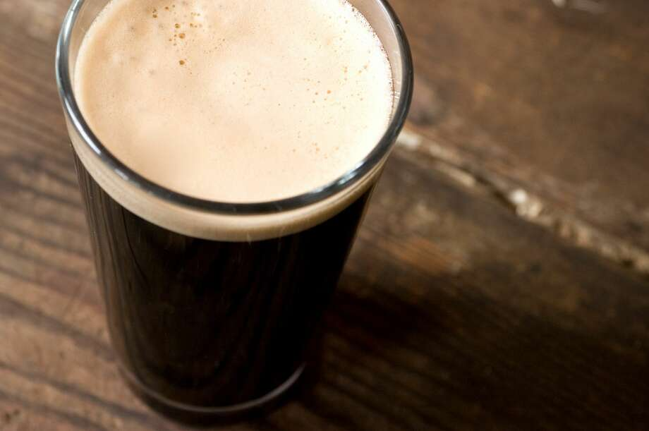 Dunkin' Donuts says its Dark Roasted Brew's stout-style suds feature 'full-roasted coffee flavor reminiscent of freshly ground beans with a creamy mouthfeel.' Pictured is a file photo of a stout beer. Photo: Kledge/Getty Images