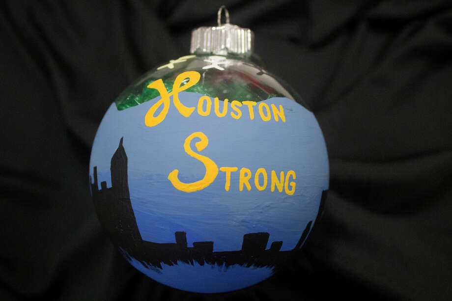 Sarah Hillebrand's ornament design featured the Houston city skyline beneath blue water, symbolizing the events of Hurricane Harvey and the area coming together in the aftermath. It will represent Texas District 138 on the 2017 Christmas tree on display at the State Capitol until Jan. 2. Photo: CFISD