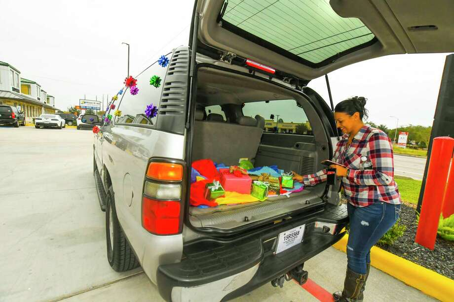 Johanna Gomez and her family were given a fully-restored 2004 Chevy Suburban. The vehicle was purchased in auction and filled with gifts for Gomez's sons, who are ages 14 and 15. Photo: Tony Gaines/ HCN, Photographer