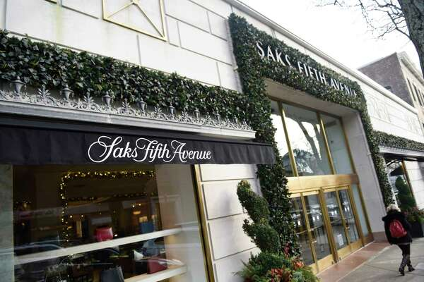 Saks Fifth Avenue is decked out in holiday decorations along Greenwich Avenue in Greenwich, Conn. Monday, Dec. 18, 2017.