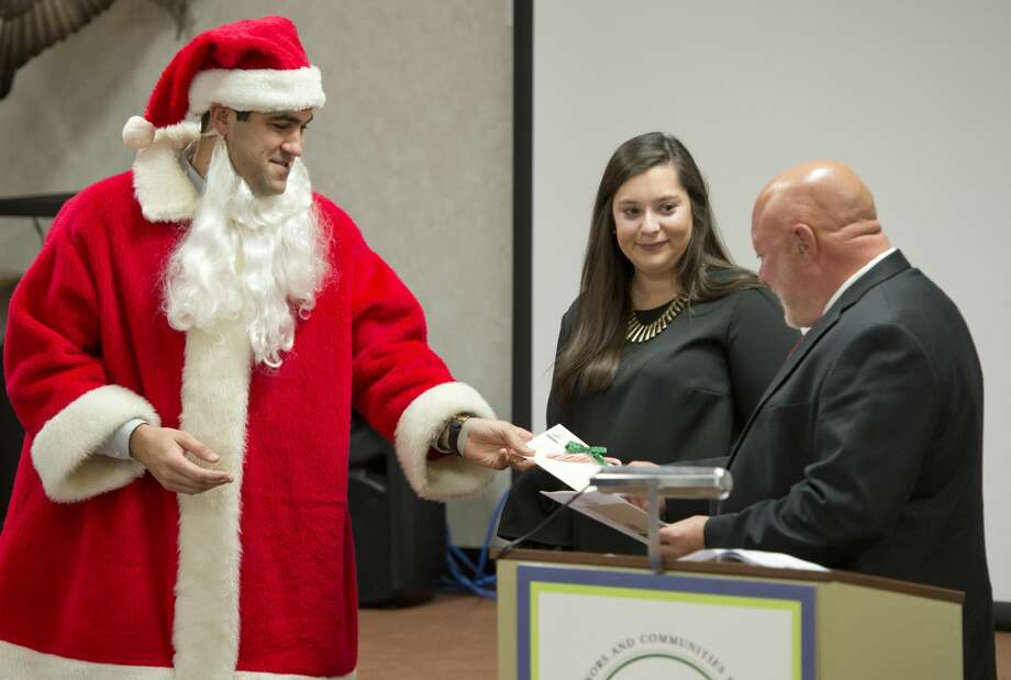 Santa helps to hand out grants to Bob Brescia and Cecelia Quinn, with PBS 12/19/17 during the Permian Basin Area Foundation year-end grant allocation. Tim Fischer/Reporter-Telegram Photo: Tim Fischer/Midland Reporter-Telegram
