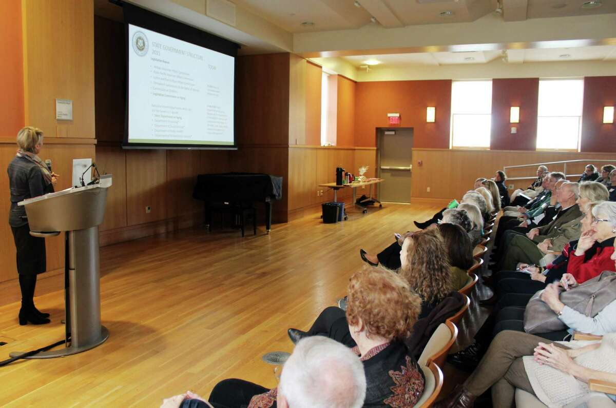 Aging consultant Julia Evans Starr addresses members at the annual meeting for At Home in Darien at the library in Darien, Conn. on Dec. 13, 2017