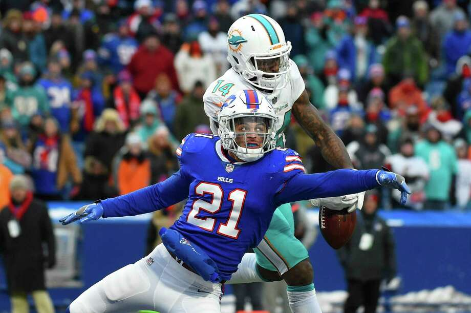 Buffalo Bills free safety Jordan Poyer (21) breaks up a pass intended for Miami Dolphins wide receiver Jarvis Landry (14) during the second half of an NFL football game Sunday, Dec. 17, 2017, in Orchard Park, N.Y. The Bills won 24-16. (AP Photo/Rich Barnes) Photo: Rich Barnes, Associated Press / FR171545 AP