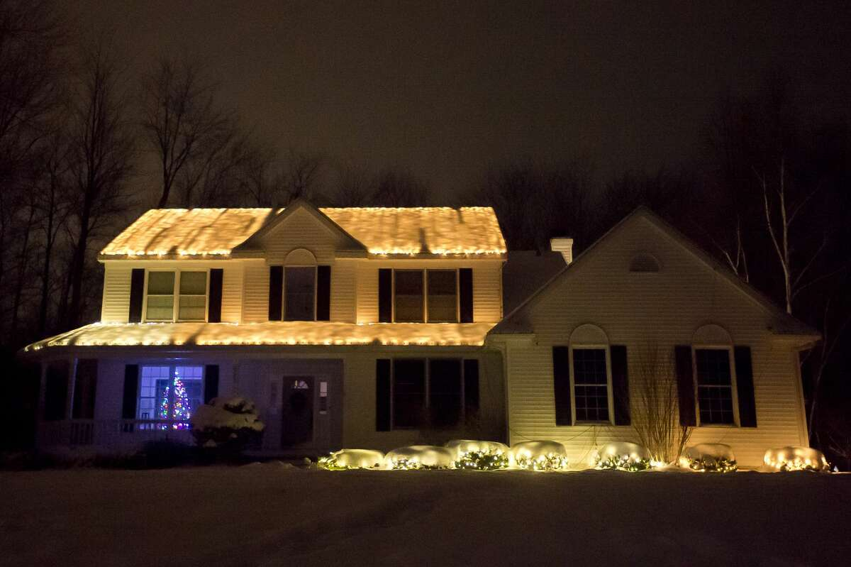 The Wyatt house is seen at different points during their Christmas lights show, which is set to music. Visitors to the house can tune their car radio to a specific station and hear Christmas songs as they watch the display. (Katy Kildee/kkildee@mdn.net)