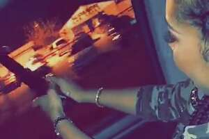 The Houston Police Department is asking anyone with information regarding the man and woman captured on video firing off guns from a moving car to contact them.