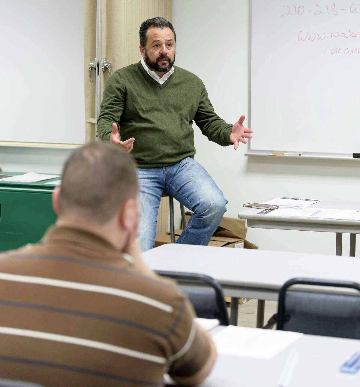 Paul Puente, Executive Secretary of the Houston Gulf Coast Building and Construction Trades Council talks to a class of new plumber apprentices at the Plumbers Apprenticeship School on Friday, December 1, 2017 in Houston Texas.