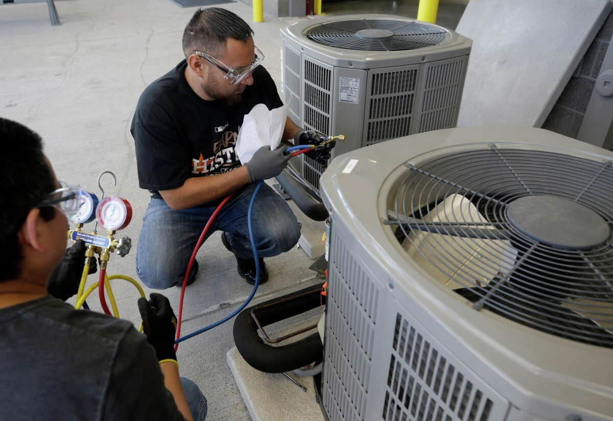 Students Roy Olguin, left, and Oscar Pena work during the HVAC level 1 and 2 certification class at Houston Community College, 13622 Stafford Rd.,Tuesday, Oct. 17, 2017, in Stafford. ( Melissa Phillip / Houston Chronicle )
