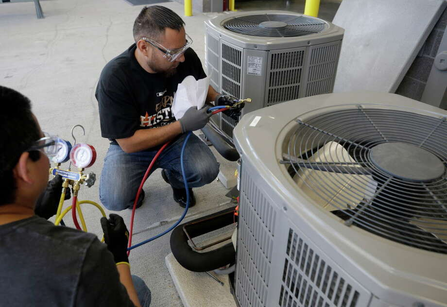 Students Roy Olguin, left, and Oscar Pena work during the HVAC level 1 and 2 certification class at Houston Community College, 13622 Stafford Rd.,Tuesday, Oct. 17, 2017, in Stafford.  ( Melissa Phillip / Houston Chronicle ) Photo: Melissa Phillip, Houston Chronicle / © 2017 Houston Chronicle