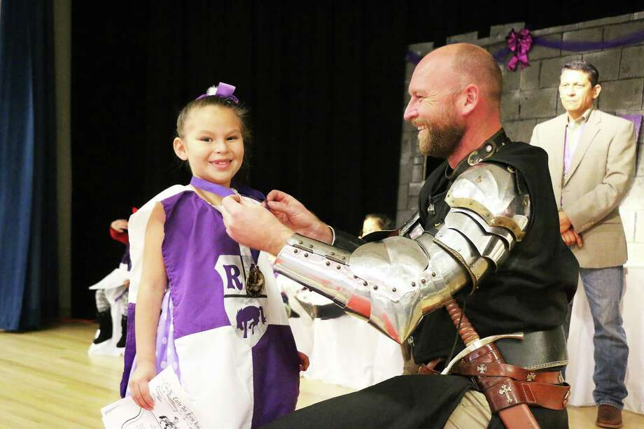 Emily Chavez is all smiles as she receives her medallion for the character trait of Responsibility from Sir James Lehman, KTJ at the Richter Elementary EarlyAct FirstKnight ceremony last Friday. Photo: David Taylor