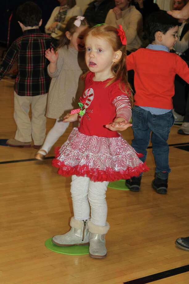 Annie Keefe is dancing her way into the Christmas spirit at Holly Pond Nursery School at the Darien Y's holiday concerts Dec. 14. Photo: Darien News / Contributed Photo / Darien News